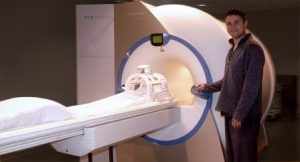 MRI Tech at Toll Gate's Warwick office shows MRI machine